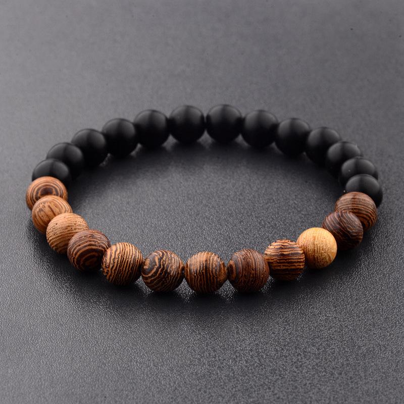 Bracelet pierre noires et perles bois